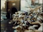 Dustmen's dispute ENGLAND London MS PAN pile of rubbish 12ft high in Berwick Street MS PAN piles of rubbish outside depot MS Man sprays rubbish CMS...