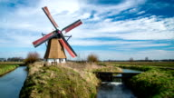Dutch Landscape with turning windmill