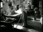 Dutch nurses woman cleaning floor sick injured MS Skinny malnutrition starving man laying in bed Indonesia WWII