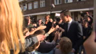 Dutch Prime Minister Mark Rutte greeting schoolchildren on voting day in the Dutch elections