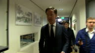 Dutch Prime Minister Mark Rutte preparing to cast his vote in the Dutch general election