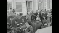 VS Dwight Eisenhower Supreme Commander of NATO and West German Chancellor Konrad Adenauer standing in front of Palais Schaumburg Adenauer's residence...