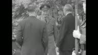 Dwight Eisenhower Supreme Commander of NATO walks out of Palais Schaumburg with West German Chancellor Konrad Adenauer they shake hands Eisenhower...