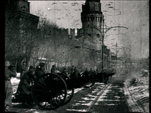Early 1920s MONTAGE B/W WS Funeral procession in Moscow for victims of Russian Civil War/ WS Soldiers firing cannons/ MS Soldiers lowering coffins into graves at Red Square graveyard/ Russia