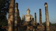 Early Sun shining on Wat Mahathat at Sukhothai Historical Park, Thailand
