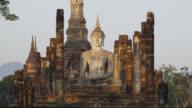 Early Sun shining on Wat Mahathat at the Historical Park, SUKHOTHAI, Thailand