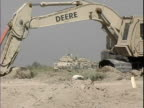 Earth mover digging dirt during construction at Patrol Base Hawkes / Arab Jabour Iraq / AUDIO