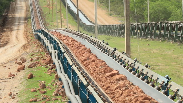 Earth moving by conveyor.