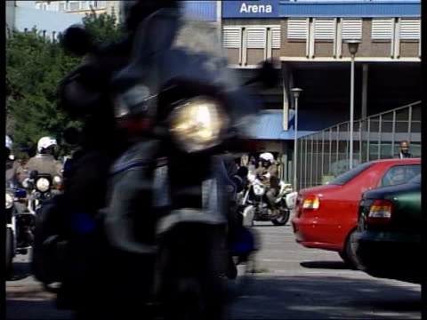 Adviser attacks government record LIB AFRICA Johannesburg EXT Police motorcyclists along Delegates arriving for summit INT Delegates registering EXT...