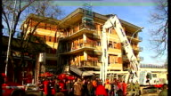 Earthquake aftershock / Rescue efforts Earthquake aftershock / Rescue efforts ITALY L'Aquila EXT Firefighters crowding round damaged fourstorey...