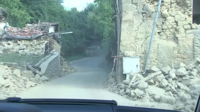 Day of mourning as three British victims named ITALY Lazio Amatrice Sommati SHOT along past houses damaged by earthquake EXT Various shots ruined...