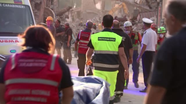 Earthquake strikes town of Amatrice and surrounding area At least 120 killed as death toll rises ITALY Amatrice EXT Stretcher carrying body bag...