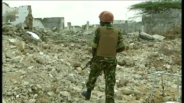 AlShabaab maintains ban on western aid agencies Soldier stands amongst ruins of buildings holding rifle
