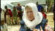 AlShabaab maintains ban on western aid agencies Badbaado Camp Rozanne Chorlton and aid worker talking to woman refugee Rozanne Chorlton interview SOT