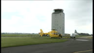 East Anglian Air Ambulance general views East Anglian Air Ambulance on tarmac / paramedic standing near helicopter / Air ambulance taking off and...