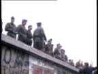 East German guards on top of wall West Germans beginning to pull down sections of the wall are sprayed by Eastern water cannon Fall of the Berlin...