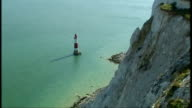 Beachy Head EXT High Angle view of cliff face and lighthouse at Beachy Head on sunny day Rescuers and emergency services on clifftop