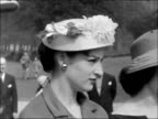 Easter parade showcases Easter bonnets ENGLAND London Hyde Park EXT Models wearing Easter bonnets along through park and standing in a line /...