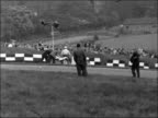 Easter race meeting at Brands Hatch ENGLAND Kent Brands Hatch EXT Cars away from grid at start of motor race / Cars around bend / Car along track /...