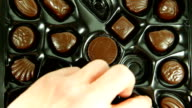 Eating a box of Chocolates. HD