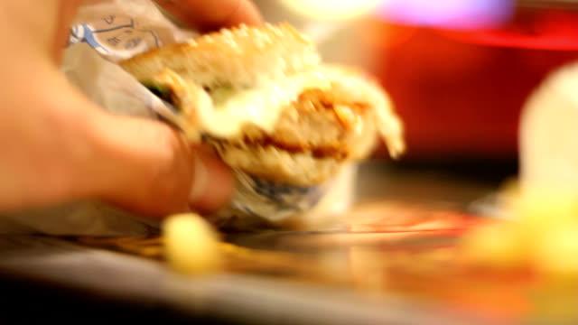 Eating a chicken burger