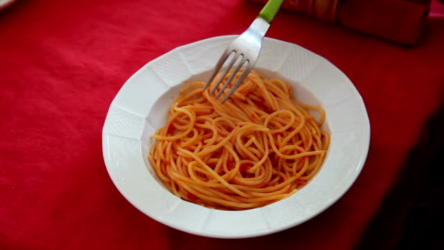 Eating a plate of Spaghetti
