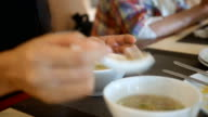 Eating asian breakfast