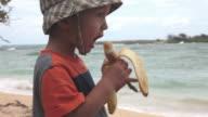 Eating banana on the beach - HD 30P