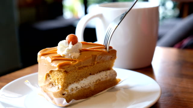 eating cake in coffee shop