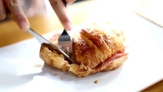 Eating croissant