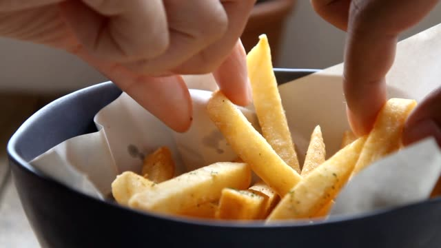 eating french fries with mayonnaise