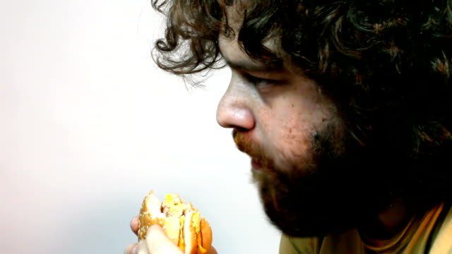 Eating Hamburger in Close Up