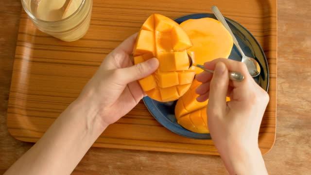 eating mango.