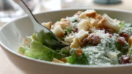 Eating salad with cream souce