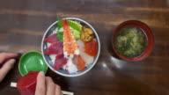 Eating Sashimi Rice Bowl at Tsukiji Fish Market in Tokyo