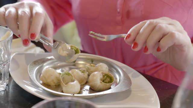 Eating snails in restaurant in 4K