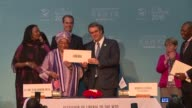 Ebola ravaged Liberia joins the World Trade Organization at the bodys first ministerial conference in Africa