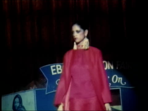 Ebony Fashion Fair Presents 'What's Goin' On' a fashion show created by Ebony Magazine / black women modeling 1970s fashions including evening gowns...