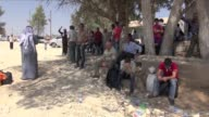Economic hardship and fighting between Kurdish factions and hardline Islamist groups in Syria displaced tens of thousands of Kurds in August with...
