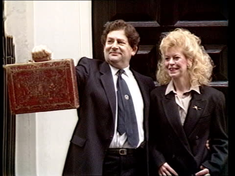 Autumn Financial Statement Background ENGLAND CMS Chancellor Nigel Lawson wife Therese London outside no 11 as Lawson holds up red 11 Downing budget...