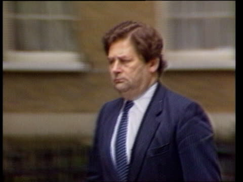 Autumn Financial Statement ULM1098 22786 CMS Chancellor Nigel Lawson along PAN RL ULM1098 G Treasury building as cars parked in circular carpark TRACK
