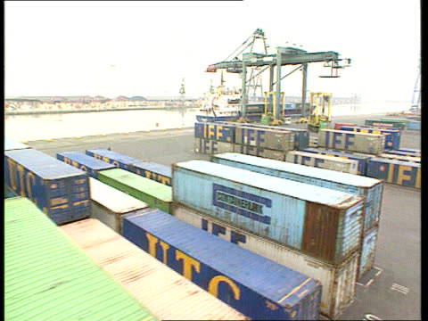 Balance of Trade Record Debt EXT ENGLAND Kent Tilbury Containers stacked in container port TRACK Mobile cranes carrying containers to be loaded onto...
