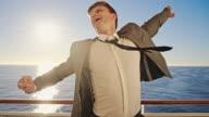 SLO MO Ecstatic businessman on a ship