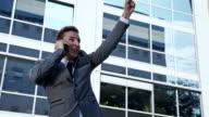 SLO MO Ecstatic businessman on the phone