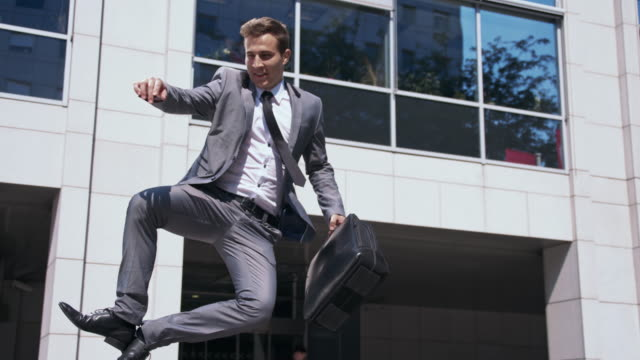 Ecstatic businessman walking out of an office