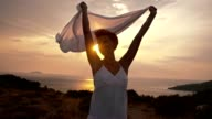 SLO MO Ecstatic woman holding white shawl in the wind