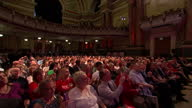 Ed Miliband speaks at NHS event in Leeds Shows interior shots Ed Miliband standing at podium giving speech in front of Save Our NHS sign asks for...