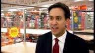 Ed Miliband visits Asda supermarket in Clapham ENGLAND London Clapham INT Ed Miliband MP interview SOT We've got to end the exploitation of zero...