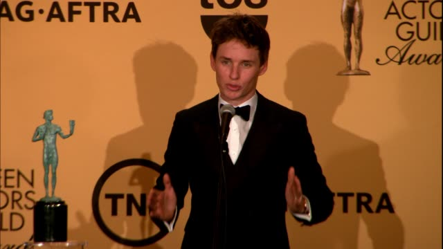 INTERVIEW Eddie Redmayne at 21st Annual Screen Actors Guild Awards Photo Room in Los Angeles CA