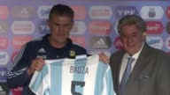 Edgardo Bauza is presented Friday as the new coach of Argentina's national football team in Buenos Aires and says he is waiting for a signal from...